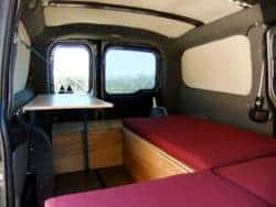 camper van inside with burgundy cushions